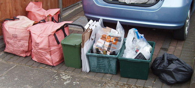 Multiple recycling boxes and bags all organised perfectly.